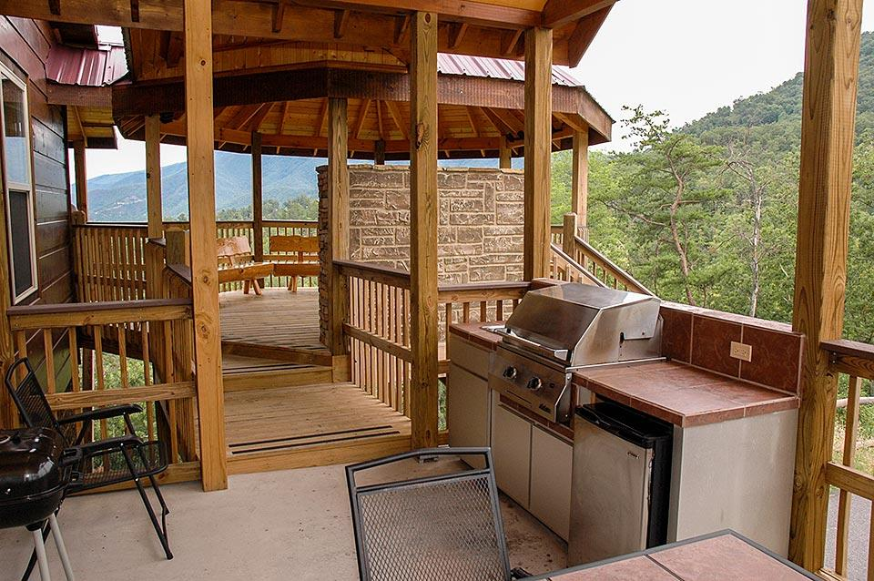 Outdoor kitchen and gazebo lounge deck for outdoor living at this cabin.