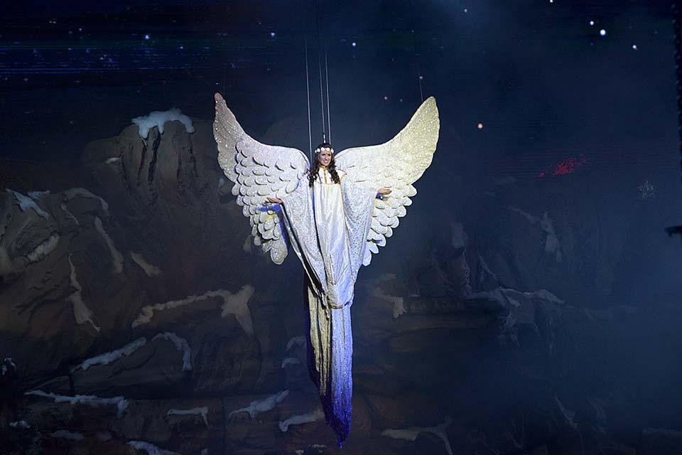 An angel flies during the Stampede Christmas show.