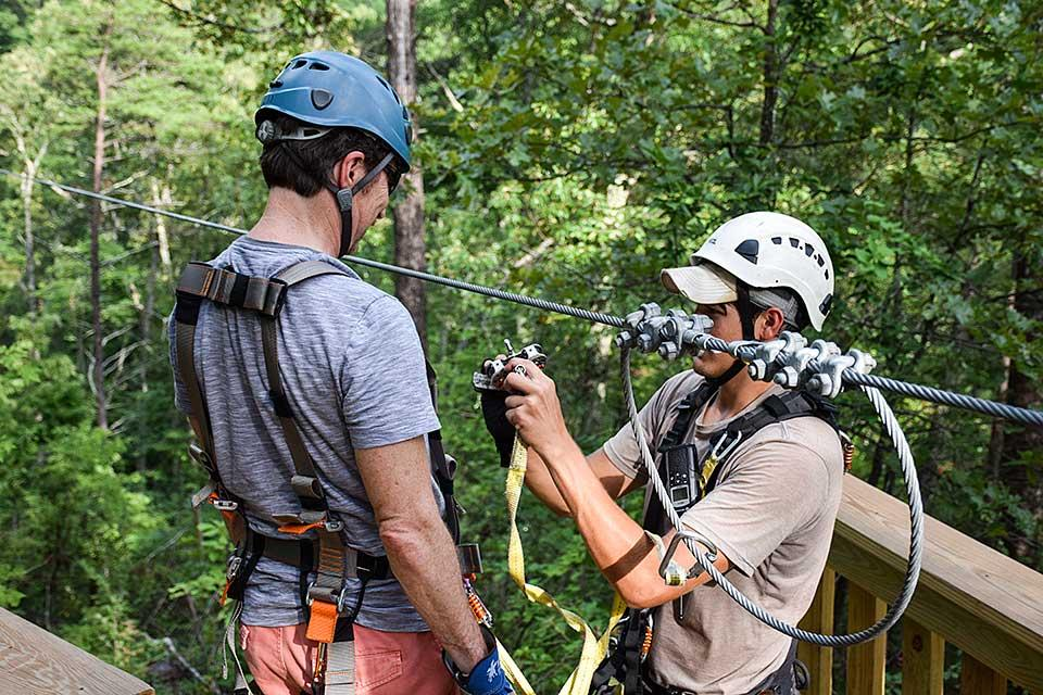 Safety is always first when attaching to the zip line.
