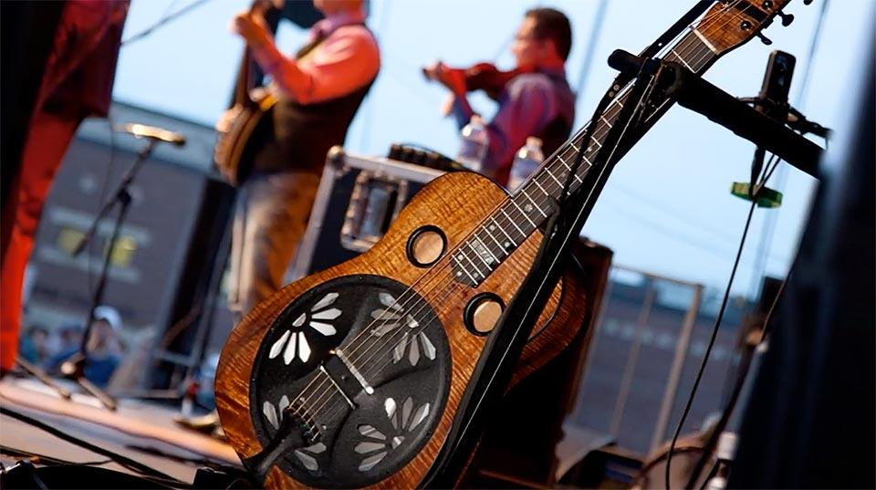 All can touch and try bluegrass instruments in the music tent.
